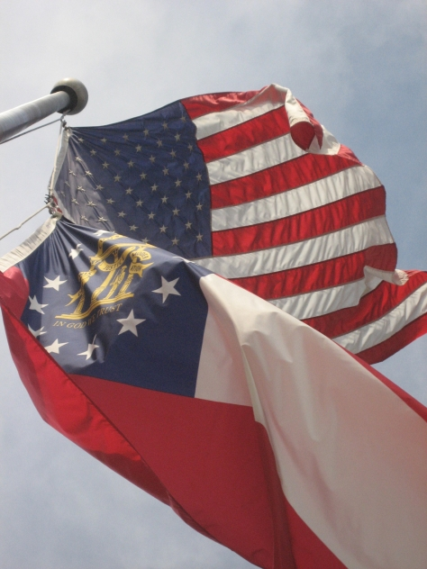 American and Georgia flags flapping in the breeze